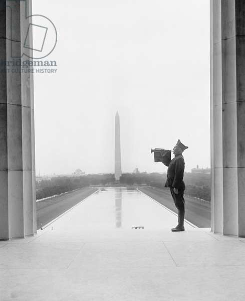 Soldier Playing Taps after Funeral of U.S. President Warren G. Harding, Washington Monument in Background, Washington DC, USA, 1923 (b/w photo)