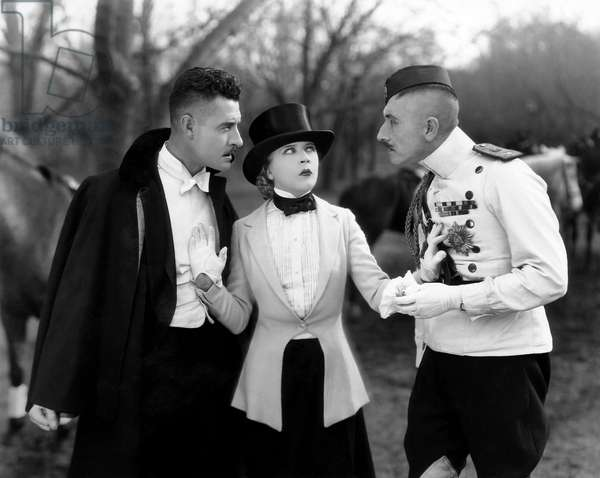 John Gilbert, (left), Mae Murray, on-set of the Silent Film