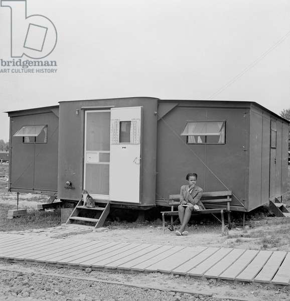 Young Woman Sitting Outside Farm Security Administration (FSA) Trailer Camp Project for African-Americans, Exterior of Expansible Trailer, Arlington, Virginia, USA, Marjorie Collins for Farm Security Administration, April 1942