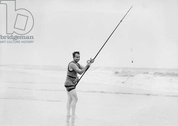 Man Surf Fishing, Long Beach, New York, USA, Bain News Service, 1914 (b/w photo)