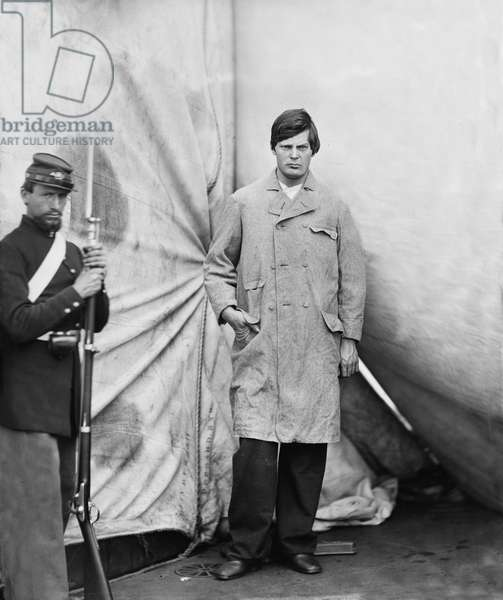 Lewis Powell, also known as Lewis Payne, Attacker of U.S. Secretary of State William H. Seward, and Conspirator in Assassination of U.S. President Abraham Lincoln, Standing in Overcoat, Washington Navy Yard, Washington DC, USA, by Alexander Gardner, April 1865 1865 (b/w photo)