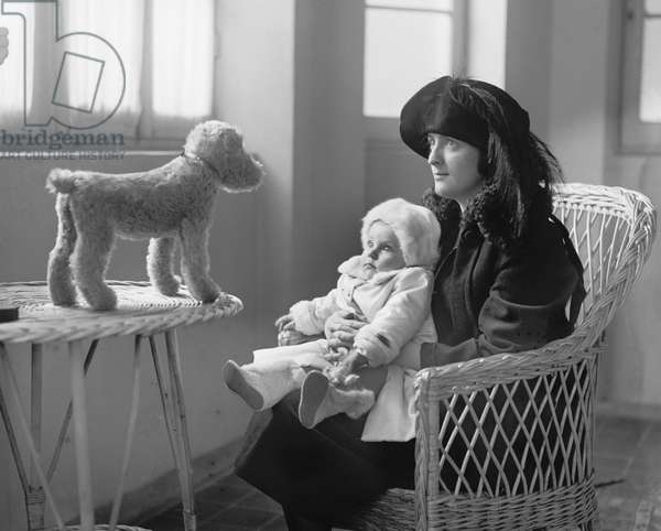 Mrs. P.A. Drury and Infant Child Staring at Stuffed Toy Dog, 1922 (b/w photo)