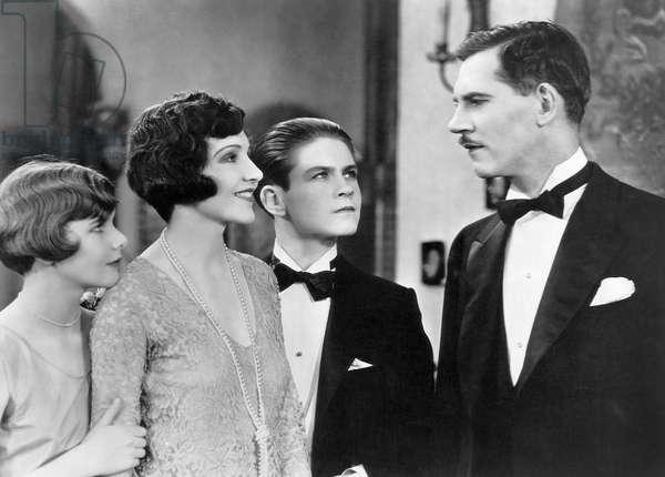 "Patricia Deering, Claudette Colbert, Tom Brown, Walter Huston, on-set of the Film, ""The Lady Lies"", 1929"