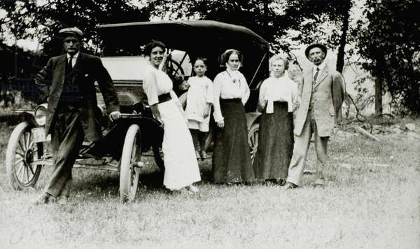 Adults and Child Standing Next to Ford Model T, 1913