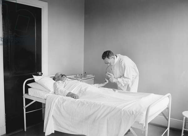 Doctor Examining Patient in Hospital, USA, 1922 (b/w photo)