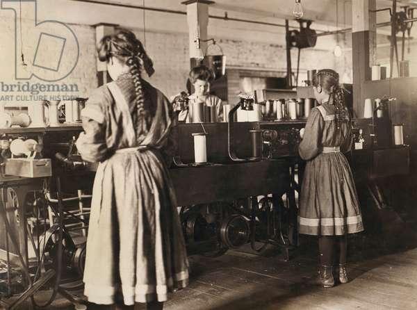 Three Girls Working in Spool Cotton Department, Bibb Manufacturing Company, Macon, Georgia, USA, circa 1909