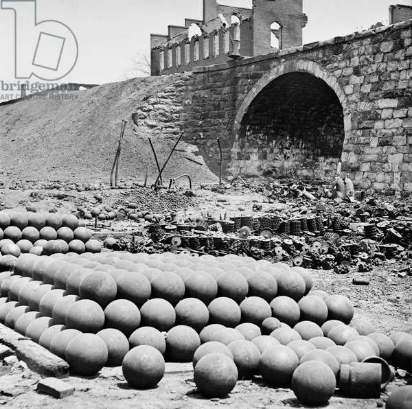 Piles of Solid Shot, Canister, etc., Arsenal Grounds; Richmond & Petersburg Railroad Bridge, American Civil War, Richmond, Virginia, USA, 1865 (b/w photo)