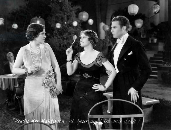 """Clara Bow (center), Stanley Smith, on-set of the Film, """"Love Among the Millionaires"""", 1930"""