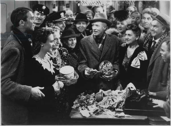 "Frank Faylen, H. B. Warner, Beulah Bondi, Donna Reed, James Stewart, Lillian Randolph, Thomas Mitchell, on-set of the Film, ""It's a Wonderful Life"", 1946  (b/w photo)"