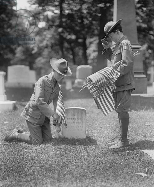 Two Boy Scouts putting American Flags at Grave of 14 Unknown Soldiers and Sailors from War of 1812, Arlington National Cemetery, Arlington, Virginia, USA, 1925 (b/w photo)