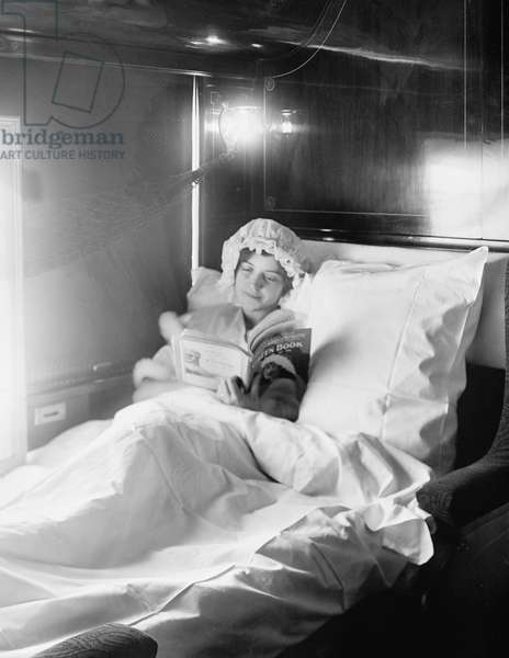 Woman Reading Book in Electric-Lighted Berth on Deluxe Overland Limited Train, USA, c.1915 (b/w photo)
