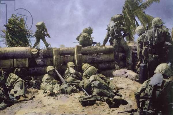U.S. Marines Climbing over Coconut Log Seawall during Battle of Tarawa, Tarawa Atoll, Gilbert Islands, November 1943 (photo)