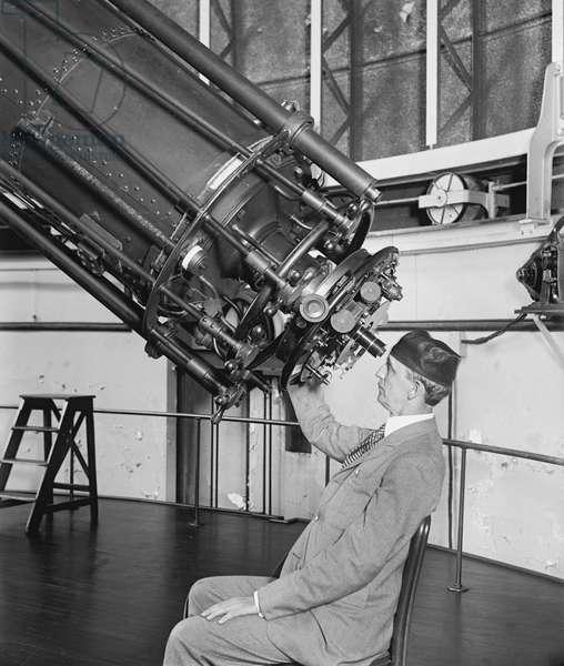 Professor H.E. Burton Looking through Telescope, Close-Up, U.S Naval Observatory, Washington DC, USA, 1929 (b/w photo)