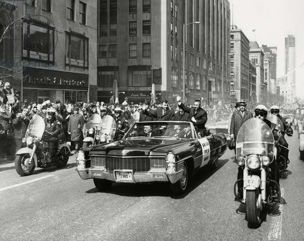 """Astronauts Virgil """"Gus"""" Grissom and John Young Being Greeted by Crowd During Parade on Michigan Avenue after Completion of Gemini 3 Space Mission, Chicago, Illinois, USA, March 30, 1965"""
