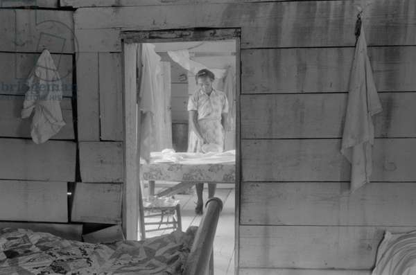 Daughter of Farm Security Administration Client Setting Table, Greensboro, Greene County, Georgia, June 1941