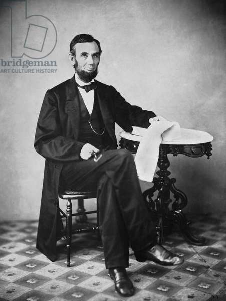 U.S. President Abraham Lincoln, Portrait, Seated next to Table, Washington DC, USA 1863 (b/w photo)