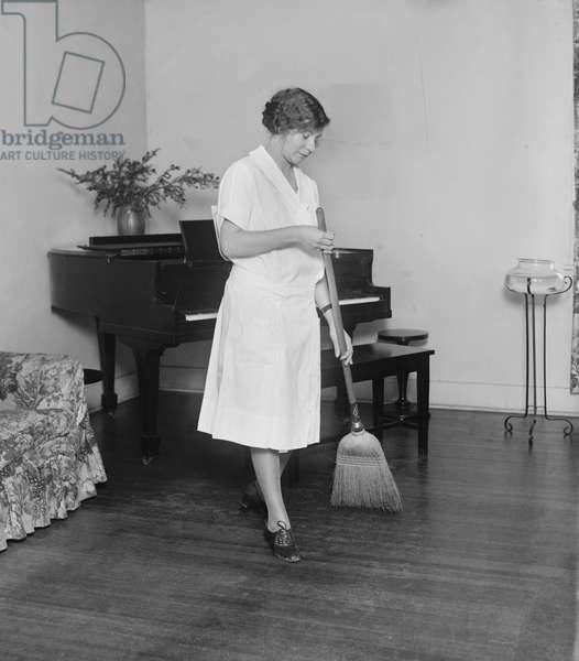 Young Woman Sweeping Floor, College Home Economics Class, Washington DC, USA, 1926 (b/w photo)