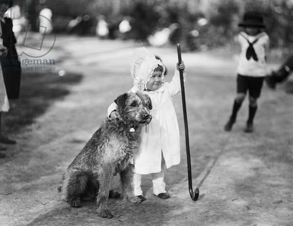 Young Girl with Dog in Park, Harris & Ewing, 1920 (b/w photo)