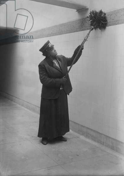 Subway Porter with Duster at Subway Station, New York City, New York, USA, 1917 (b/w photo)