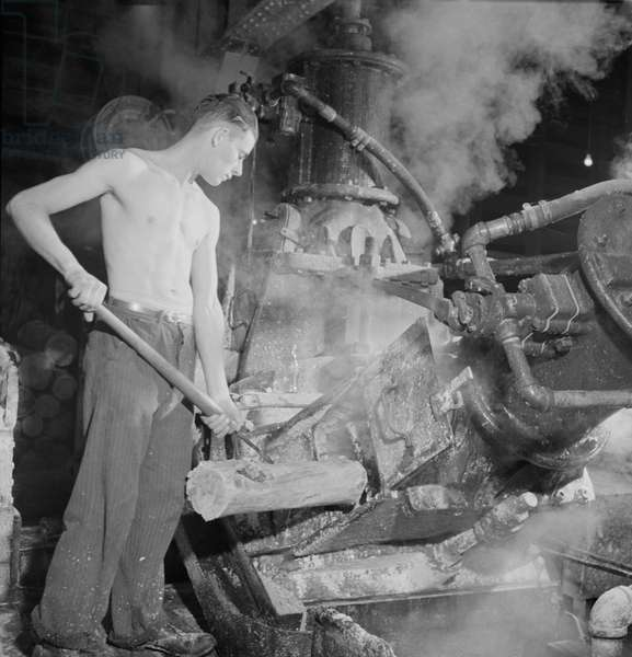 Worker at Machine that Grinds Wood into Pulp, Mississquoi Corporation Paper Mill, Sheldon Springs, Vermont, USA, September 1941