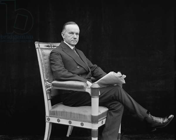 U.S. President Calvin Coolidge, Portrait with Newspaper, Washington DC, USA, 1924 (b/w photo)