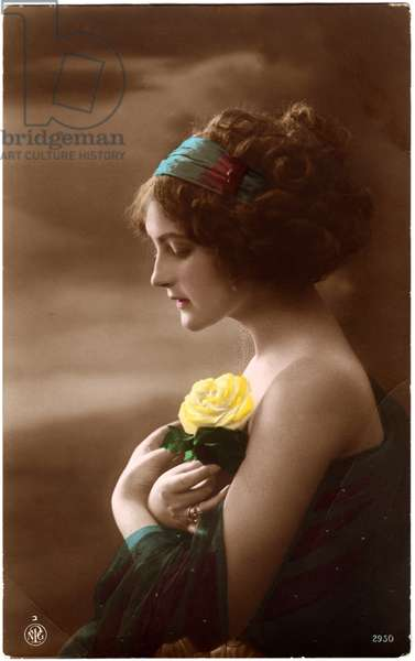 Woman in Green Dress and Headband Holding Yellow Rose against Chest, Profile, Hand-Colored Postcard. c.1920's