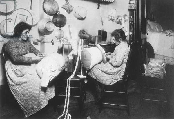 Mother and daughter making pillow lace in a tenement apartment, New York City, USA, c.1911 (b/w photo)