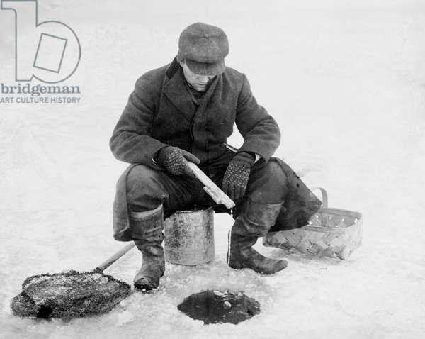 Man Fishing Through Hole in Ice, Bain News Service, circa 1910