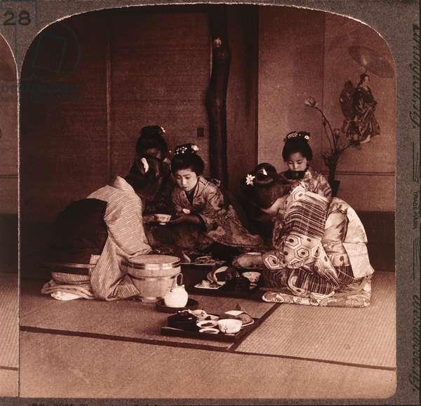 Geishas serving a meal, Tokyo, Japan, c.1904 (b/w photo)