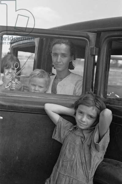 Family of Migratory Fruit Worker from Tennessee now Camped in Field near Packinghouse, Winterhaven, Florida, USA, Arthur Rothstein for Farm Security Administration (FSA), January 1937