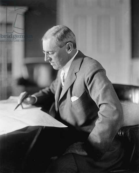 U.S. President Woodrow Wilson Reviewing Paperwork, circa 1910's