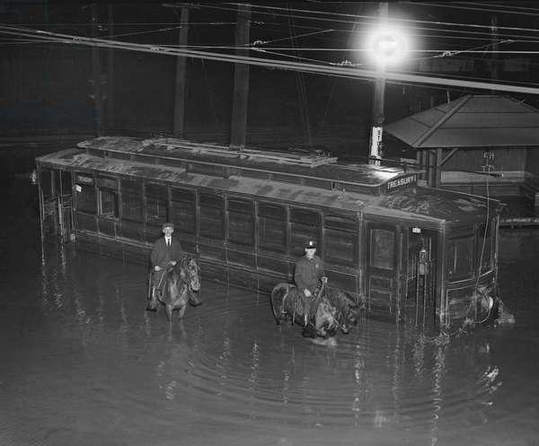 Streetcar and Two Men on Horseback during Flood, Washington DC, USA, 1923 (b/w photo)