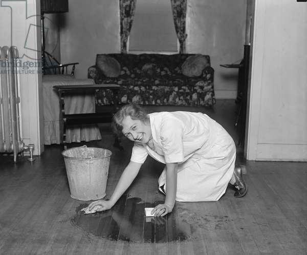 Young Woman Scrubbing Floor, College Home Economics Class, Washington DC, USA, 1926 (b/w photo)