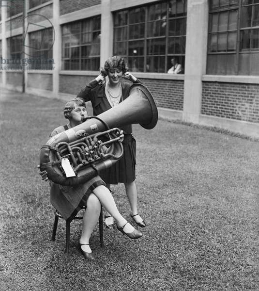Woman Playing Tuba While Another Woman is Plugging her Ears, USA, circa 1928