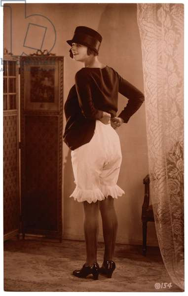 French Lingerie Model Lifting Dress to Reveal Bloomers, Rear View, 1915