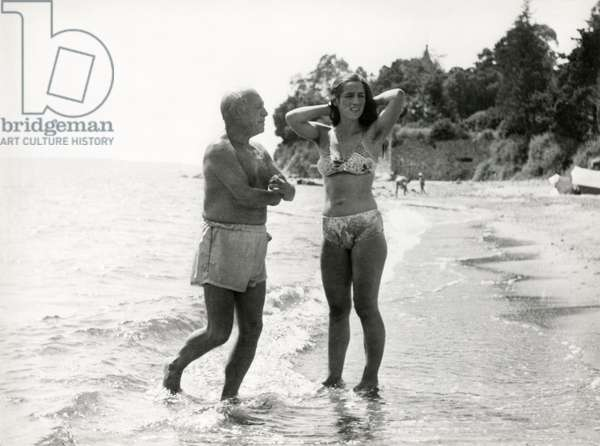 """Pablo Picasso with Françoise Gilot, still from """"La vie Commence Demain"""" (Life Begins Tomorrow), 1950"""