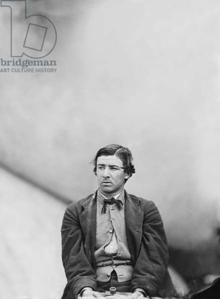 David E. Herold, Conspirator in Assassination of U.S. President Abraham Lincoln, Seated and Manacled, Washington Navy Yard, Washington DC, USA, by Alexander Gardner, April 1865 1865 (b/w photo)