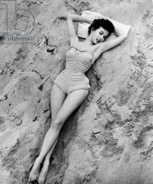 Actress Rita Moreno, Portrait in Bathing Suit on Beach, circa mid-1950's