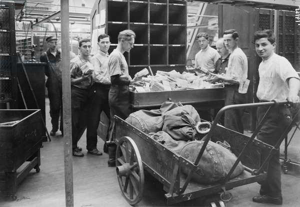 Men Sorting Mail at General Post Office, New York City, New York, USA, Bain News Service, 1914 (b/w photo)