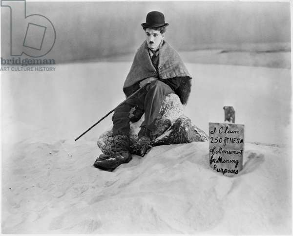 Charles Chaplin, on set of the silent film 'The Gold Rush', 1925 (b/w photo)