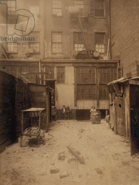 Family at Rear of Tenement Building, 134 1/2, Thompson Street, New York City, New York, USA, circa 1912