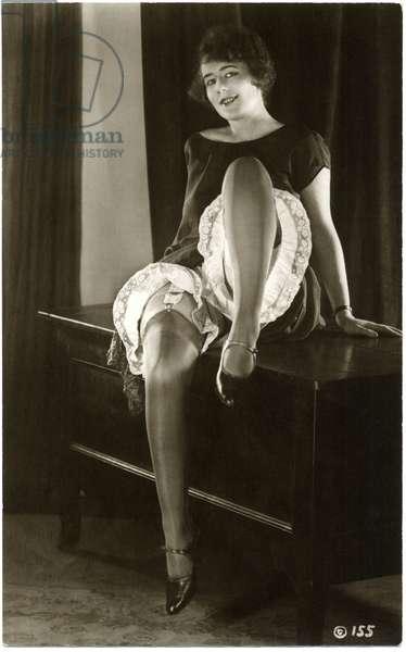 Woman Wearing Garters, Nylons & Pantaloons Sitting on Cabinet,  French Postcard, c.1920