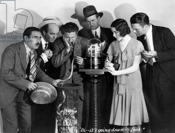 "Harry Green, (holding ticker tape), Mary Brian, Neil Hamilton, on-set of the Film, ""The Kibitzer"", 1930"