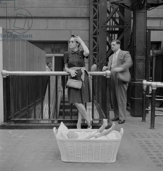 Woman with Baby in Basket Waiting for Train, Pennsylvania Station, New York City, New York, USA, Marjorie Collins for Office of War Information,  August 1942