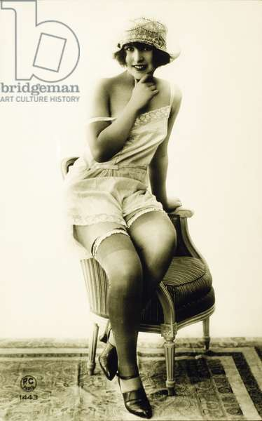 French Lingerie Model Sitting on Arm of Chair, 1920