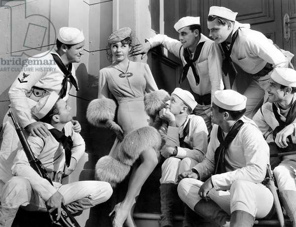 """Martha Raye surrounded by Sailors, on-set of the Film, """"Give me a Sailor"""", 1938"""