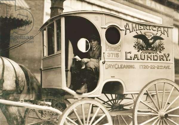 Young Boy Driving Laundry Delivery Wagon, Birmingham, Alabama, USA, circa 1914