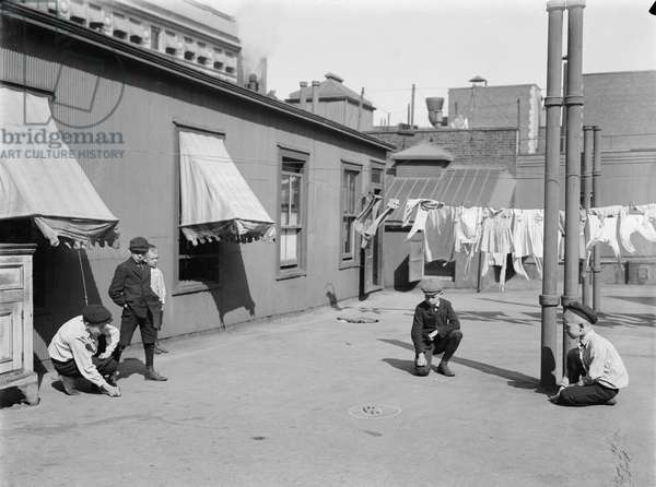 Children Playing Marbles on Apartment Building Rooftop, New York City, New York, USA, Bain News Service, 1910 (b/w photo)
