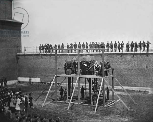 General John F. Hartranft on Scaffold Reading Death Warrant to Conspirators of Assassination of U.S. President Abraham Lincoln, Arsenal Prison, Washington, DC, USA, by Alexander Gardner, July 7, 1865 1865 (b/w photo)