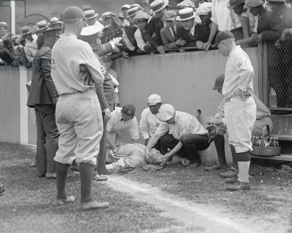 Babe Ruth, Major League Baseball Player, New York Yankees, Knocked out in front of Segregated Section of Fans during Ball Game, Washington DC, USA,  1924 (b/w photo)